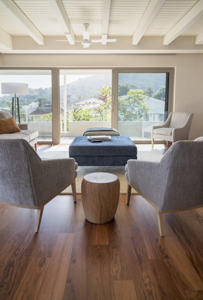 armchairs on hardwood floor in home