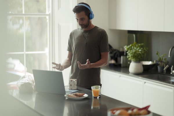 man with headphones working from home