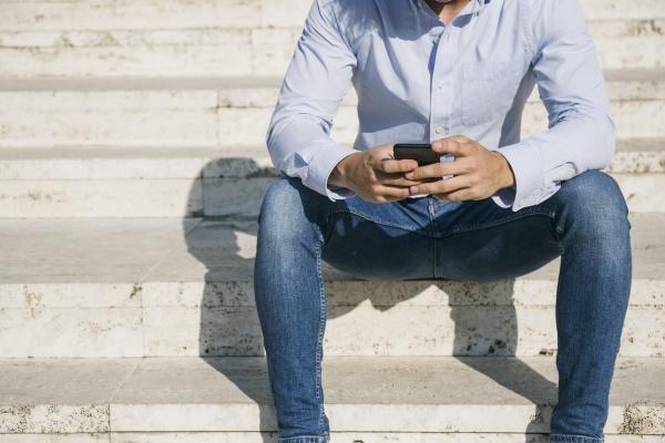 man surfing internet through smart phone