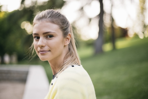 beautiful woman smiling in public park