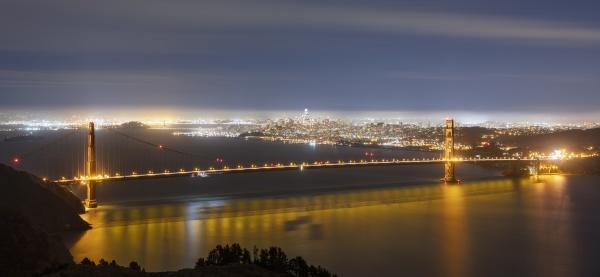 glowing golden gate bridge at night
