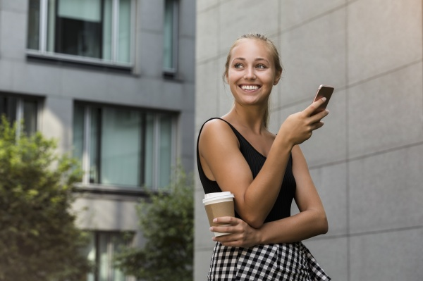 smiling beautiful woman holding coffee cup