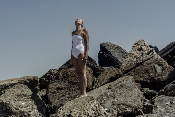 senior woman wearing swimwear standing on