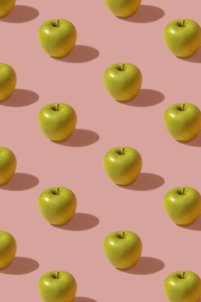 pattern of green apples against pink