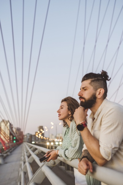 couple looking away while leaning on