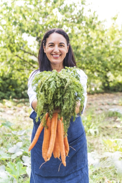 smiling mature woman holding fresh harvested