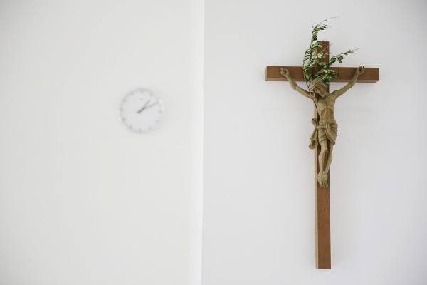 cross and clock in a presbytery