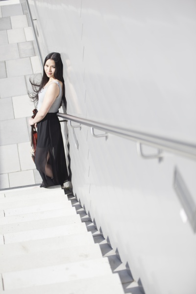 young female asian with violin standing