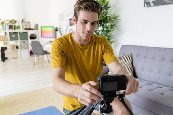 trainer adjusting camera for live streaming