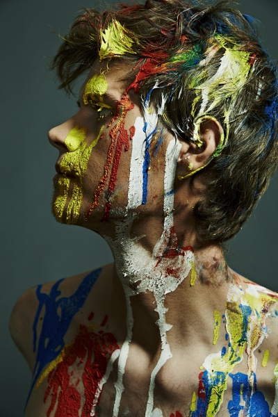 profile of shirtless man with paint