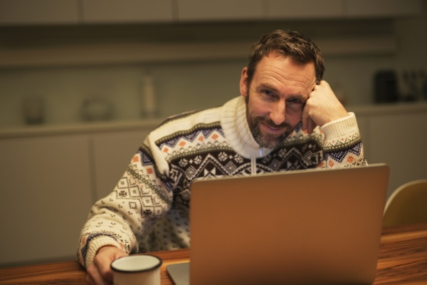 casual businessman using laptop on table