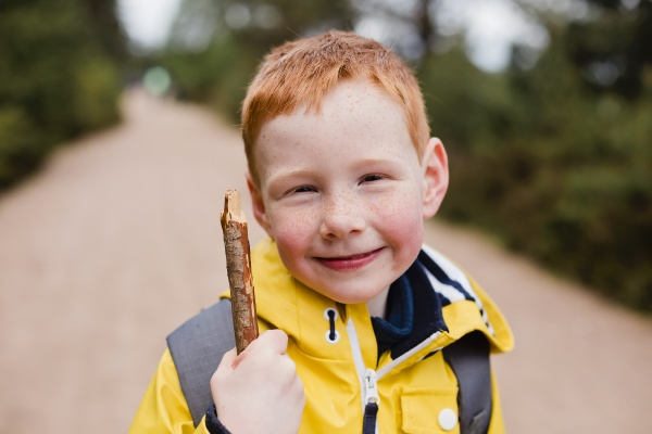 portrait of redheaded little boy with