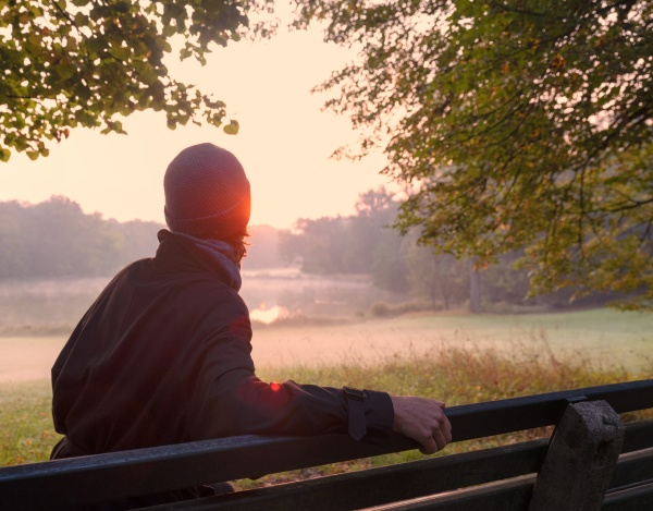 mature woman looking at sunrise view