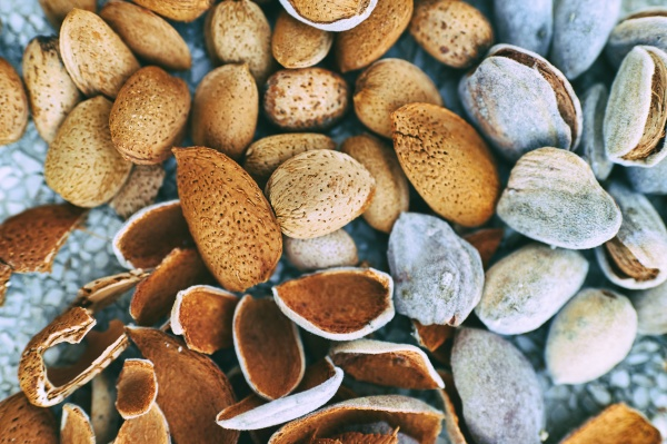 husks and fresh unpeeled almonds