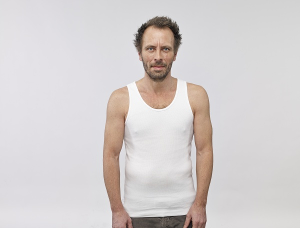portrait of man wearing white vest