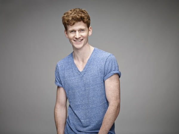 portrait of laughing redheaded young man