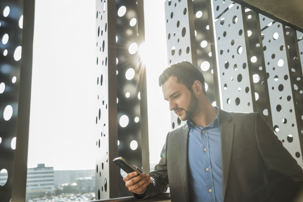 young businessman looking on cell phone