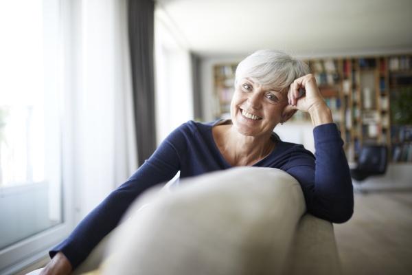 smiling senior woman relaxing while sitting