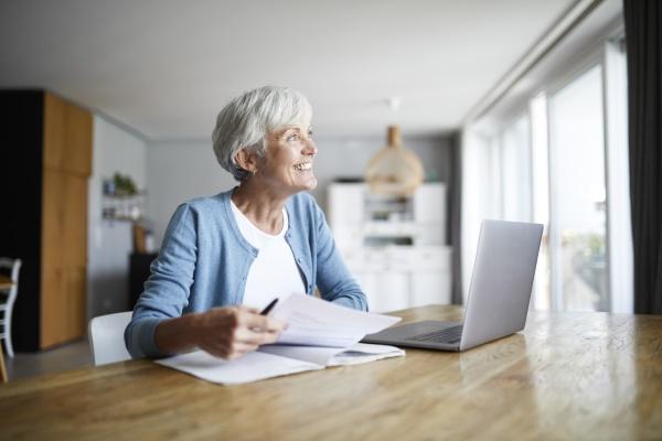 active senior woman doing paper work