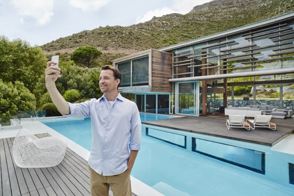 mature man taking selfie on smart