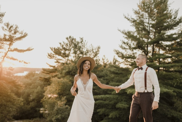 smiling couple holding hands while standing