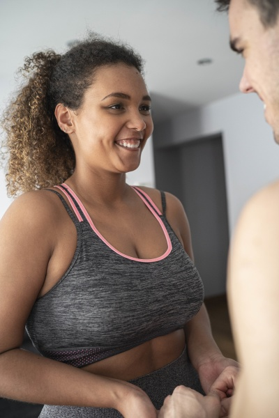 woman wearing sports clothing looking at
