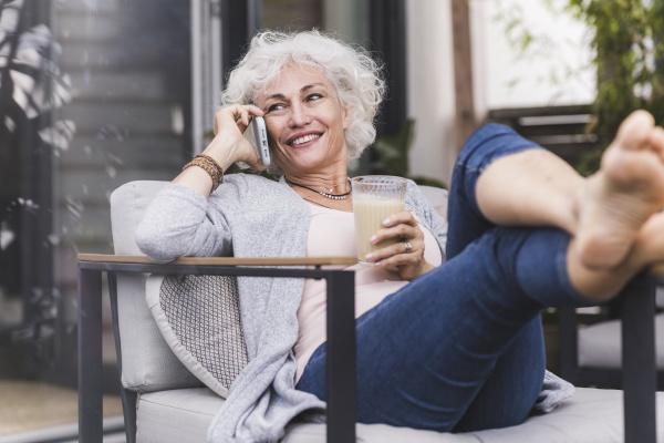 mature woman talking on smart phone
