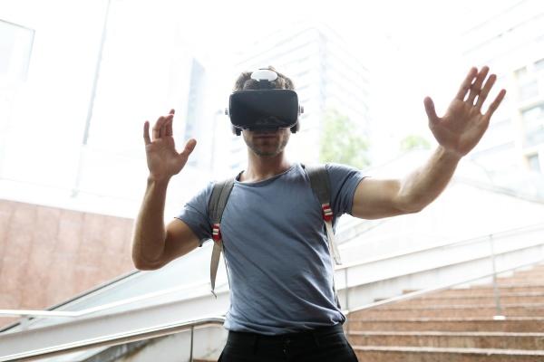 young man enjoying virtual reality headset