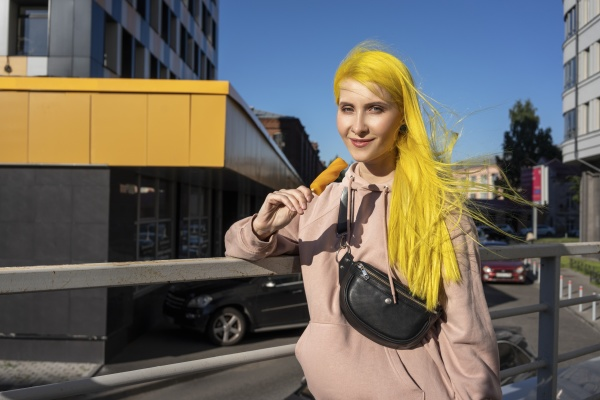 dyed yellow hair woman eating ice