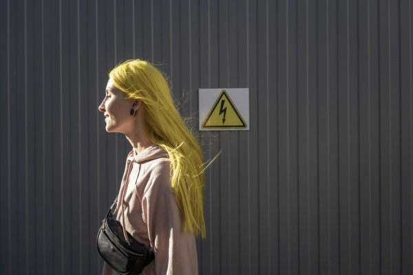 young woman looking away while standing