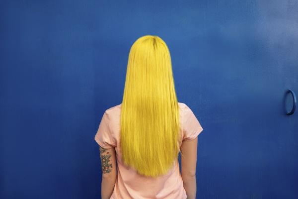 long hair woman looking at blue