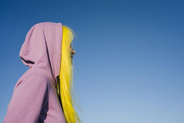woman wearing hooded shirt looking away