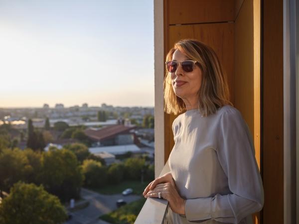 senior woman standing in hotel balcony