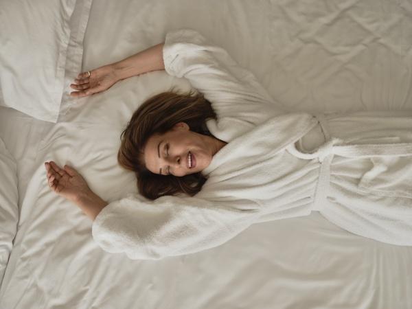 smiling senior woman lying on white