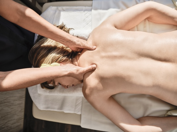 hands of mature female giving massage