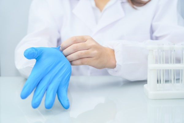 scientist hands putting in nitrile blue