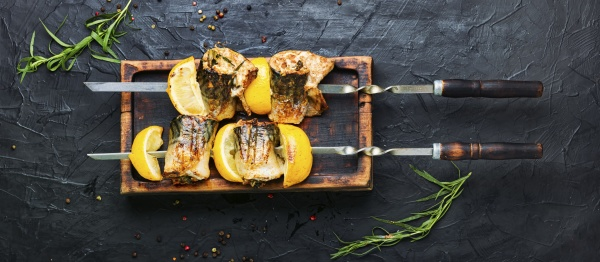 barbecue mackerel fish on skewers