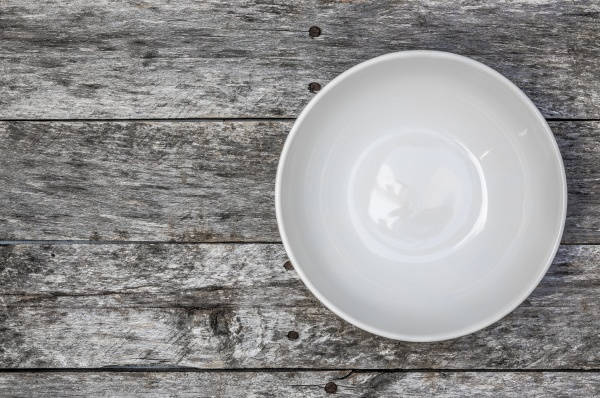 empty bowl on gray wood top