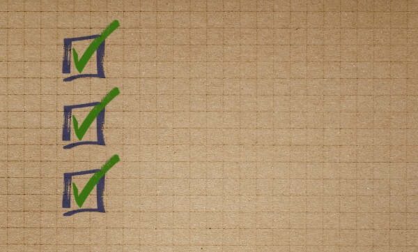 checklist on checkered recycled paper writing
