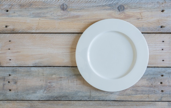 empty plate on used look wooden