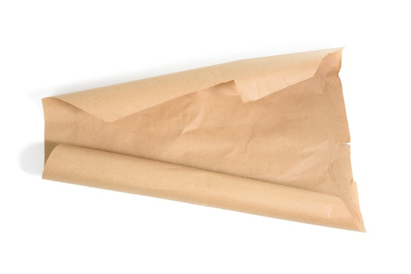 roll of brown wrapping paper isolated