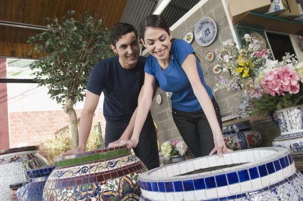couple choosing a flower pot