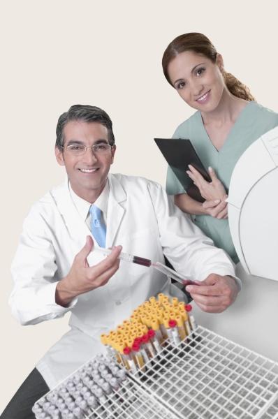 lab technician filling blood in a