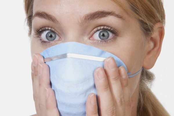 female doctor wearing a flu mask