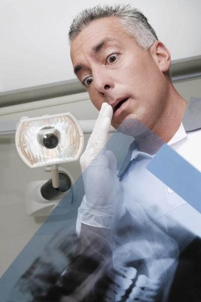 dentist examining an xray report