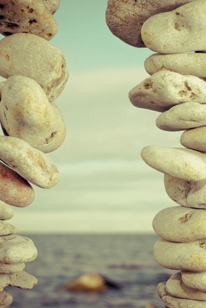 sea viewed through stacks of pebbles