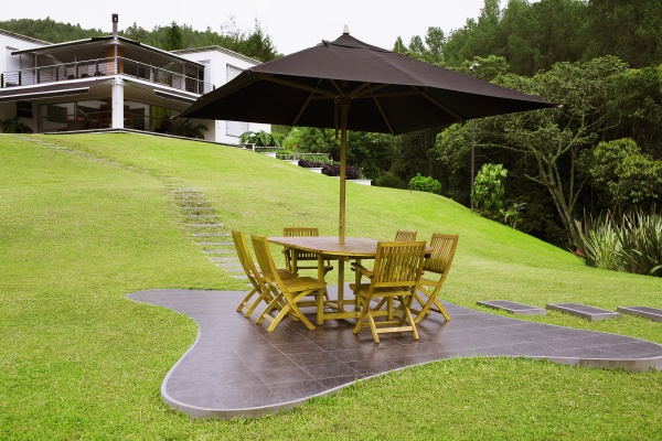 table and chairs under a patio