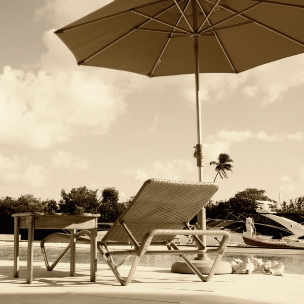 patio umbrella with lounge chair at