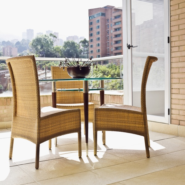 wicker chairs with a table in