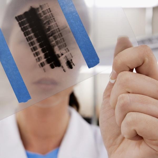 female scientist examining a report in